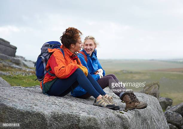 hikers sitting on large rock in moorland - wonderlust stock pictures, royalty-free photos & images