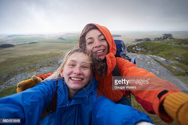 Hikers take a self portrait from the top of a hill