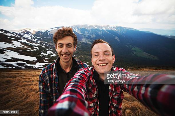 Hikers takes selfie portrait on mountain top