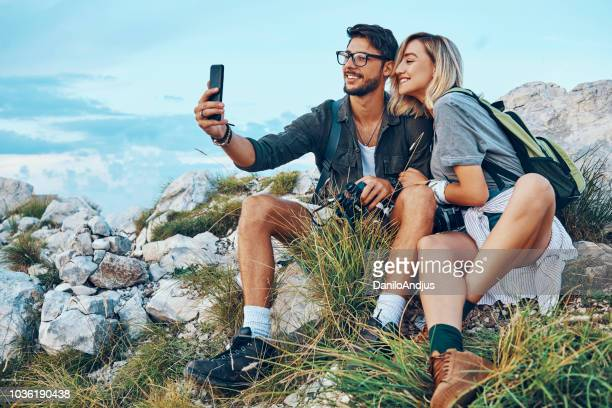 hikers taking a selfie on top of the mountain - balkans stock photos and pictures