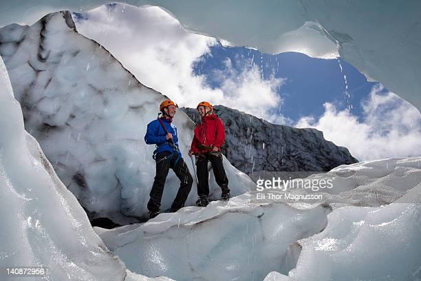 Hikers talking on melting glacier