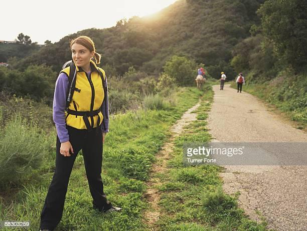 Hikers trekking across countryside