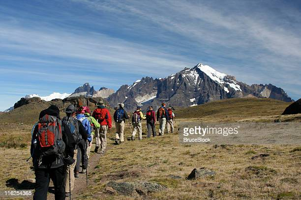 hikers trekking in mountains in patagonia - torres del paine national park stock photos and pictures