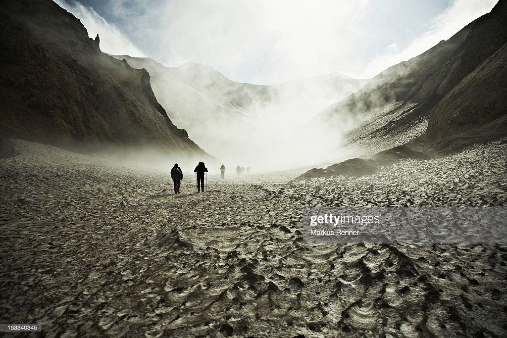 Hikers trekking through the Mutnovsky Volcano, Kamchatka, Russia : Stock Photo