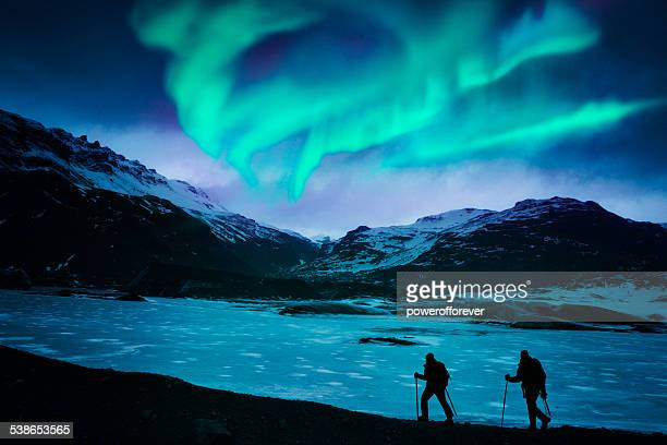 hikers under the northern lights - aurora borealis stock pictures, royalty-free photos & images