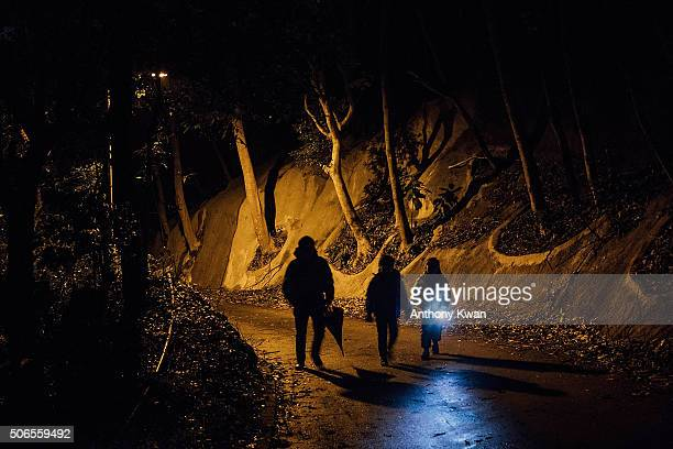 Hikers walk uphill in subzero temperature at Kowloon Peak on January 24 2016 in Hong Kong Hong Kong Hong Kong was hit by a cold snap today with...