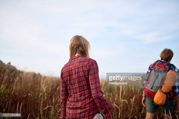 Hikers Walking In The Rye