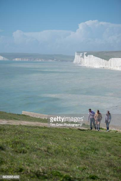Hikers Walking near the Seven Sisters Cliffs