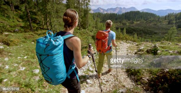 Hikers walking on mountain trail