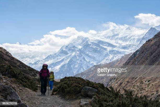 hikers walking on the trail in Nepal, on Annapurna Circuit