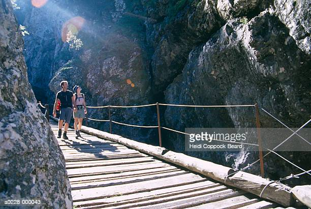 hikers walking over bridge - heidi coppock beard fotografías e imágenes de stock