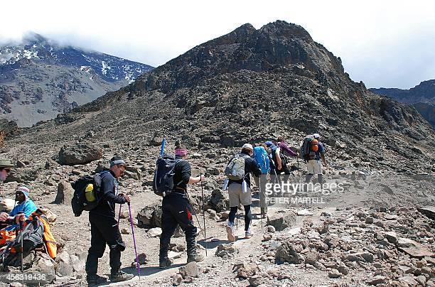 Hikers with along a trekking route at Mount Kilimanjaro Tanzania on September 26 2014 Mount Kilimanjaro is a dormant volcanic mountain in Tanzania It...