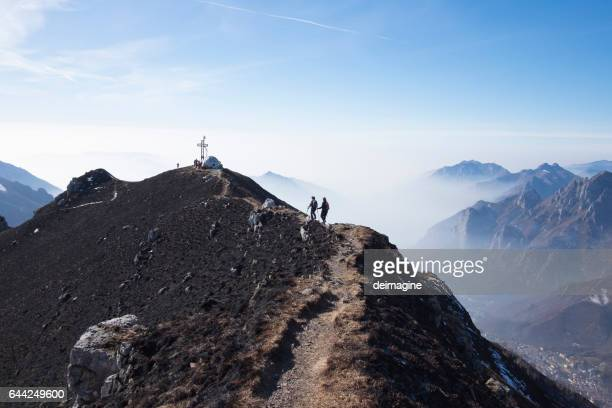 hikers woman walking on a mountain ridge - ridge stock pictures, royalty-free photos & images