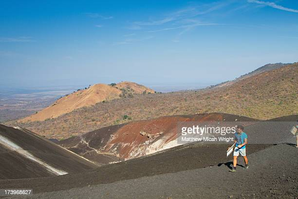 Hikiers climb Cerro Negro for Volcano Boarding
