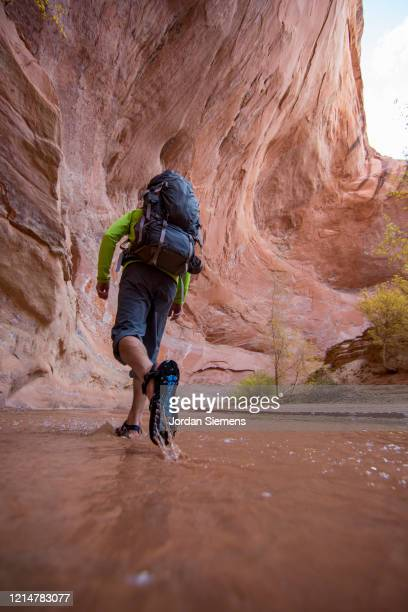 hiking a slot canyon in the utah desert - st. george utah stock pictures, royalty-free photos & images