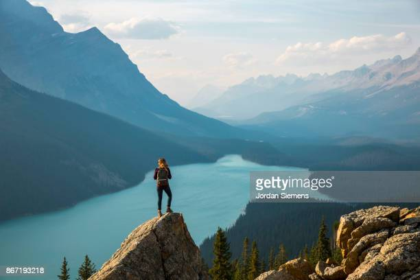 hiking above a lake - travel destinations stock-fotos und bilder