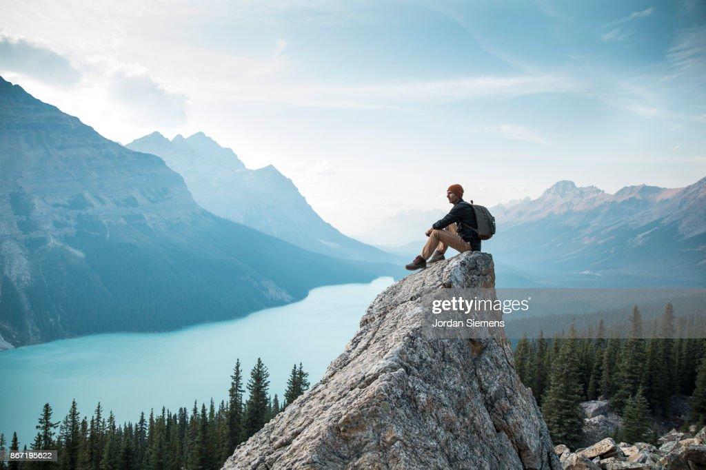 Hiking above a lake : Stock Photo