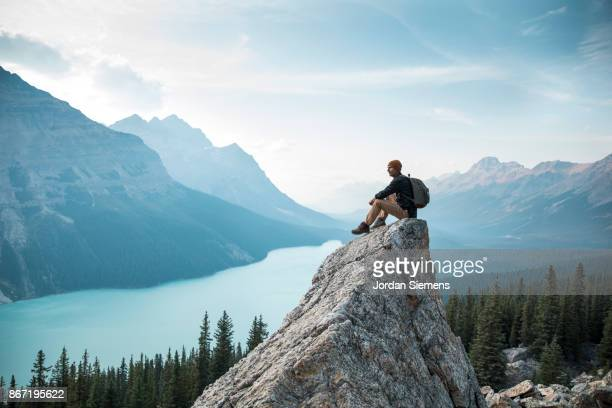 hiking above a lake - one mid adult man only stock pictures, royalty-free photos & images
