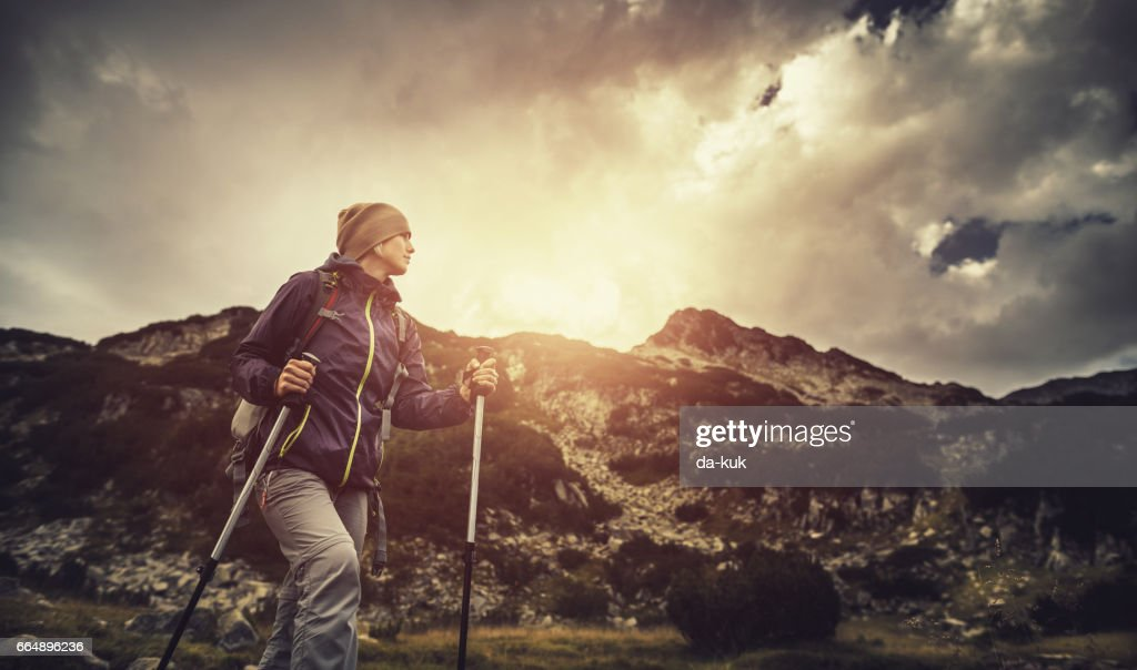 Hiking alone in the mountains : Stock Photo
