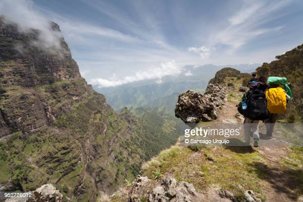 Hiking alongside a canyon in Simien Mountains