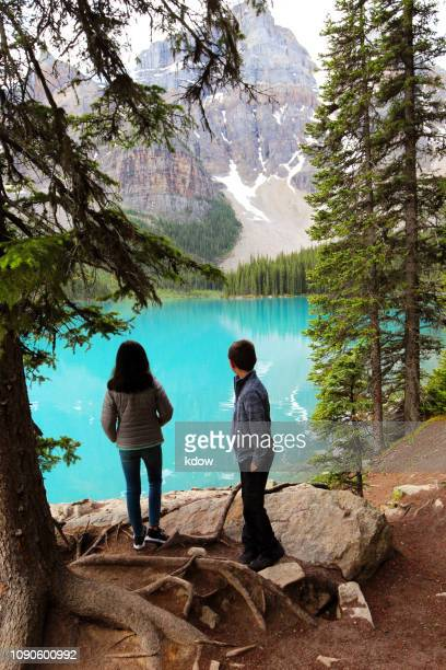 hiking around moraine lake in banff national park - lake louise lake stock photos and pictures
