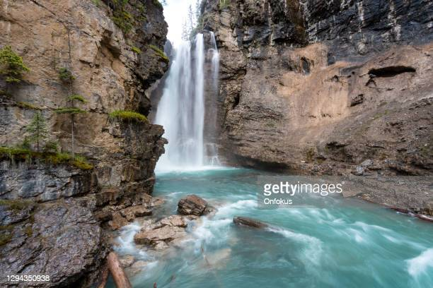 hiking at johnson canyon in banff national park, canada - falling water flowing water stock pictures, royalty-free photos & images
