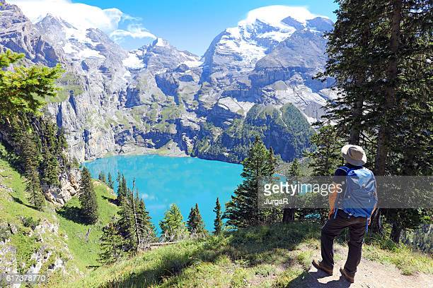 Hiking at Oeschinen Lake in Berner Oberland in Switzerland