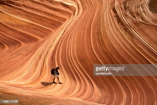 hiking at the wave in arizona - the hobbit: an unexpected journey stock pictures, royalty-free photos & images