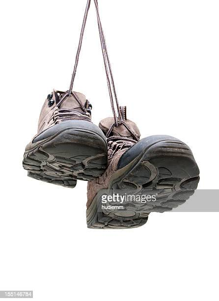hiking boots hanging isolated on white background - hiking boot stock pictures, royalty-free photos & images