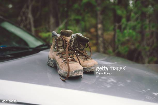 Hiking boots over a car