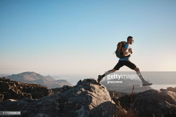hiking challenges you to push past your limits - jumping stock pictures, royalty-free photos & images