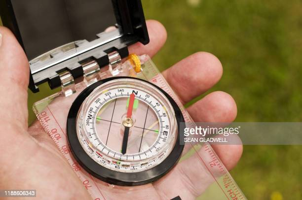 hiking compass - compass stock pictures, royalty-free photos & images