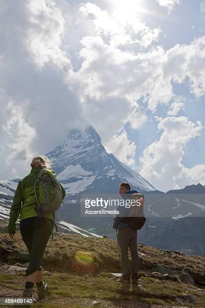 Hiking couple look up to Matterhorn summit