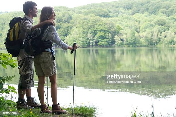 Hiking couple looking at lake