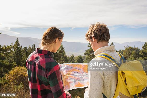 Hiking couple reading map