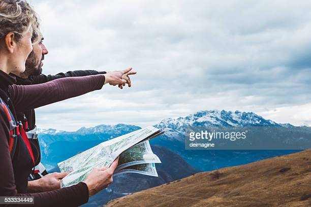 hiking couple with map in mountain - guidance stock pictures, royalty-free photos & images