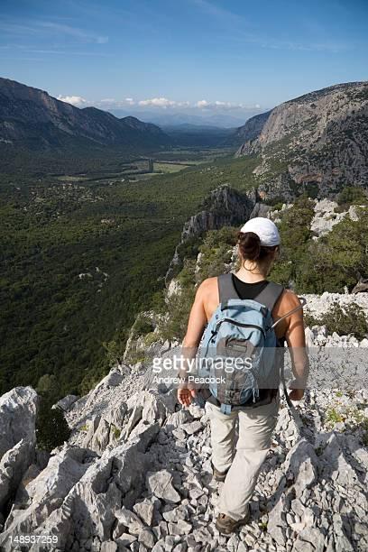 hiking down from tiscali mount in valle di lanaittu. - cerdeña fotografías e imágenes de stock