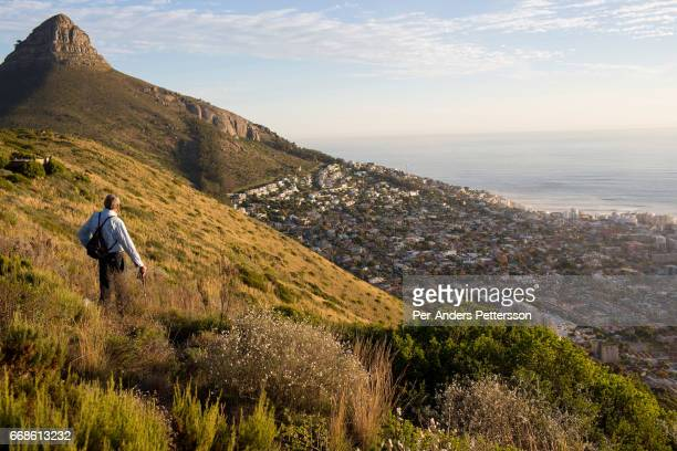 Hiking expert Mike Lundy poses for a portrait on a path with a view of Lions head mountain on May 23 2014 in Cape Town South Africa The city offers...
