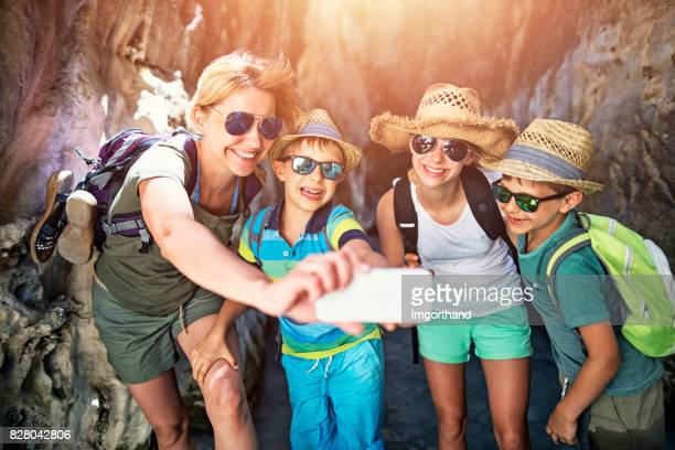 Hiking family taking selfie in river canyon, Andalusia, Spain