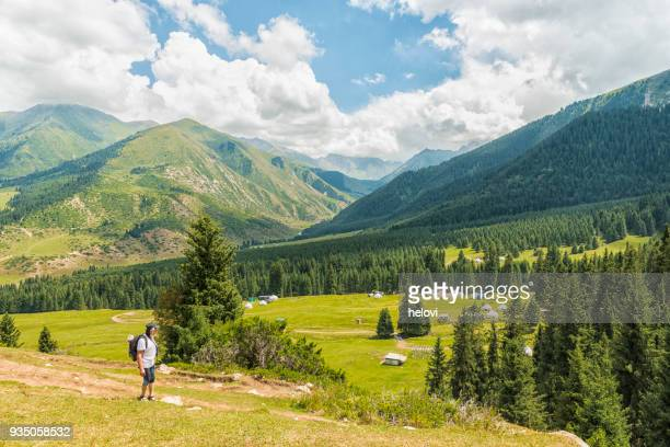 hiking in green landscape in kyrgyzstan - kyrgyzstan stock pictures, royalty-free photos & images