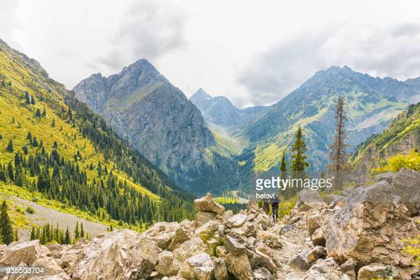hiking in rocky landscape in kyrgyzstan - kyrgyzstan stock pictures, royalty-free photos & images