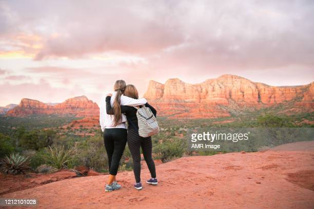 hiking in sedona at sunset. - arizona stock pictures, royalty-free photos & images
