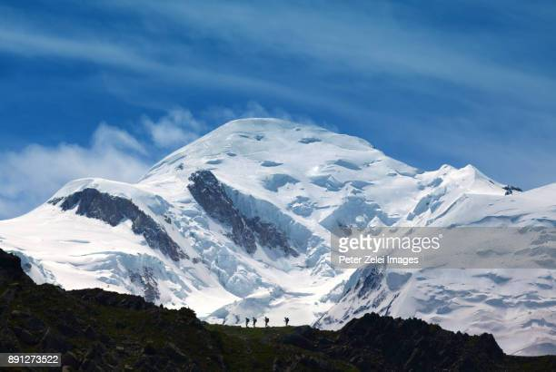 hiking in the mountains, in the background the mont blanc - monte bianco foto e immagini stock