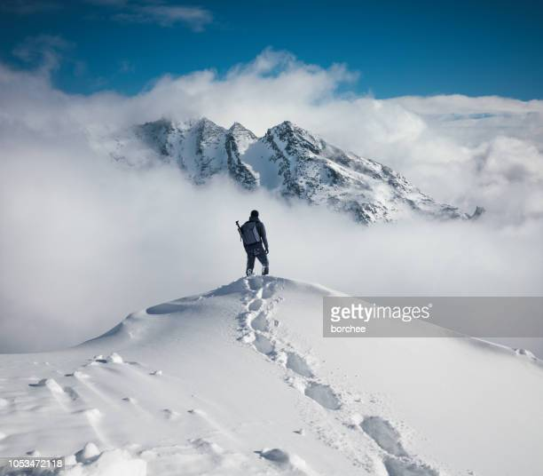 hiking in the mountains - deep snow stock pictures, royalty-free photos & images