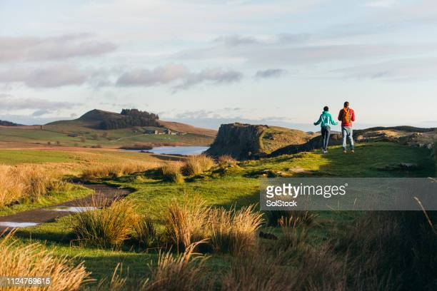 hiking in the northumberland hills - northeastern england stock photos and pictures