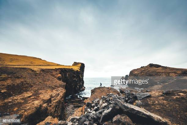 hiking on valahnukur cliffs in iceland - wide angle stock pictures, royalty-free photos & images
