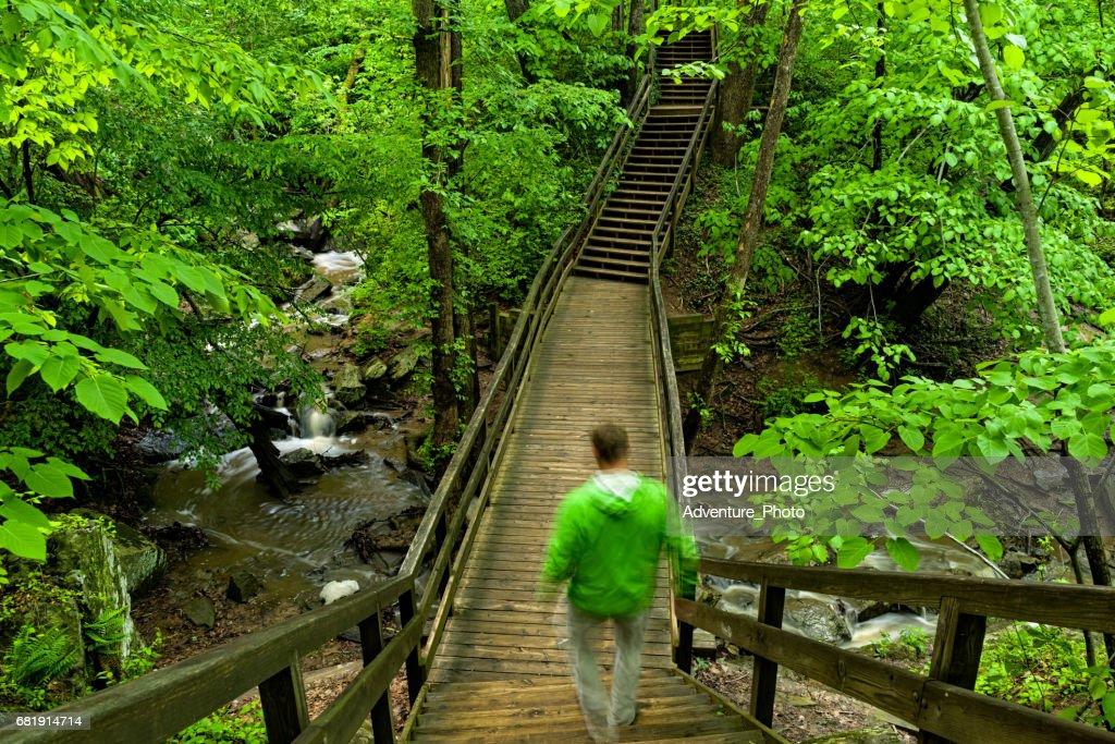 Hiking Over Creek on Bridge in Great Falls Virginia : Stock Photo