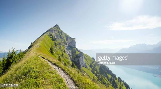 hiking path along alpine ridge line, augstmatthorn, switzerland - extreme terrain stock pictures, royalty-free photos & images