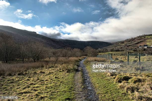 hiking path - nigel owen stock pictures, royalty-free photos & images