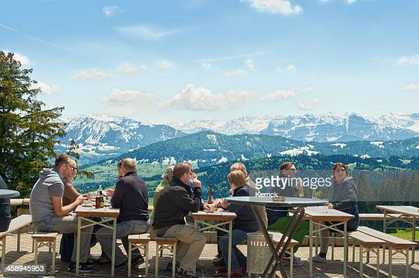 hiking people resting at pfander with view to bregenzerwald - vorarlberg stock photos and pictures
